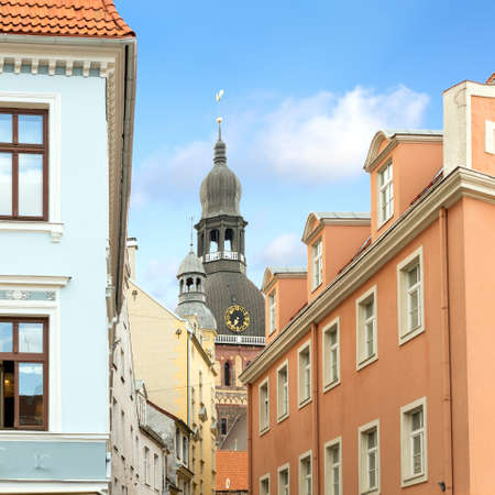 Church spire and houses in old town of Riga