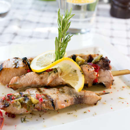Swordfish fillet grilled with souse, lemon and rosemary