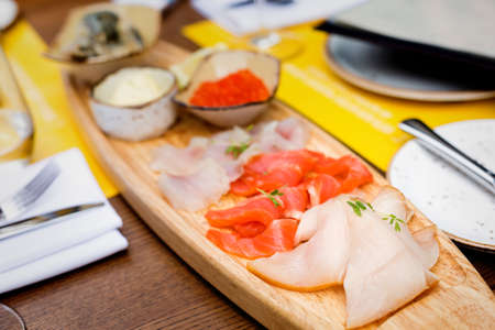Selection of fish including soft-salted pike perch, sea trout, smoked butterfish, salmon caviar, lamprey 스톡 콘텐츠