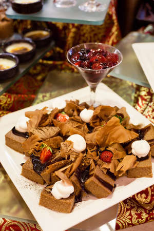Variety of chocolate desserts with strawberry and kisses photo