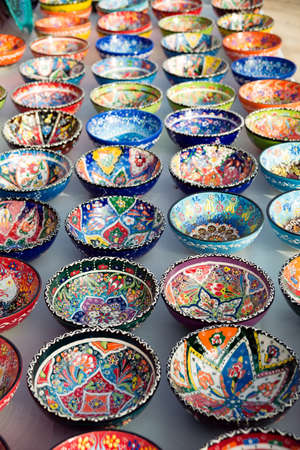 Collection of turkish traditional  handpainted pottery bowls in souvenir shop.  Shallow depth of field