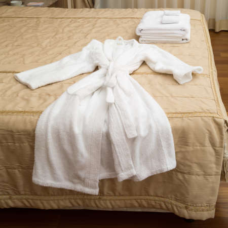 keeping room: White towels piled on the hotel bed Stock Photo