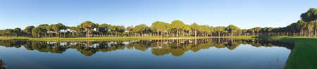 Panoramic view of a golf course with a pond Imagens