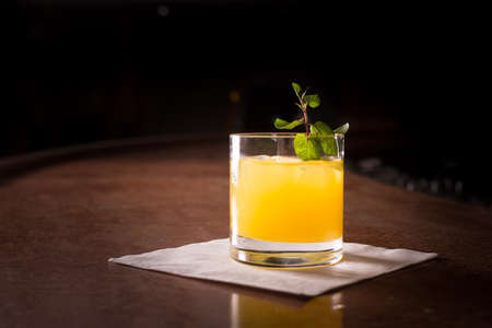 alcohol screwdriver: Screw driver cocktail with fresh mint on the dark background Stock Photo