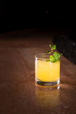 the screw driver: Screw driver cocktail with fresh mint on the dark background Stock Photo