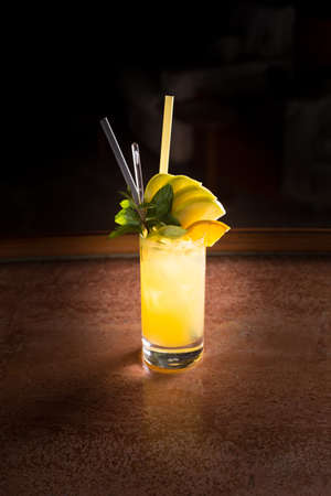 alcohol screwdriver: Screw driver cocktail with fresh mint on the dark background. Shallow DOF Stock Photo