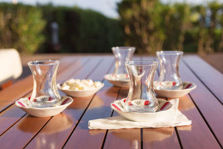 locum: Turkish tea cups with locum in outdoor cafe. Direct sunset light. Shallow DOF and lightly toned