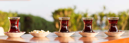 locum: Turkish tea with locum in outdoor cafe. Direct sunset light. Shallow DOF and lightly toned