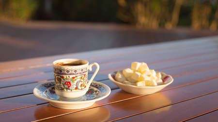 locum: Locum and turkish coffee in outdoor cafe. Direct sunset light. Shallow DOF and lightly toned Stock Photo
