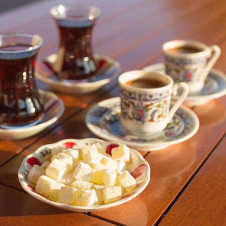 locum: Locum, turkish coffee and turkish tea in outdoor cafe. Direct sunset light. Shallow DOF and lightly toned