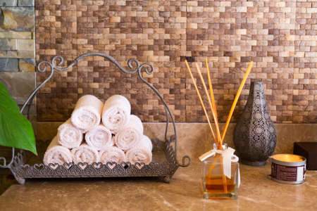 swimming candles: Concept of spa essentials. Towels, aroma, candle. Spa interior. Shallow DOF