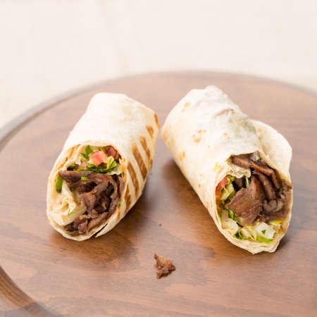 Doner kebab on wooden background. Natural light, square Stock Photo