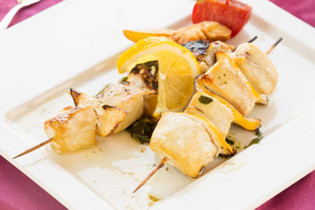 Swordfish on skewer with tomato and pepper. Horizontal