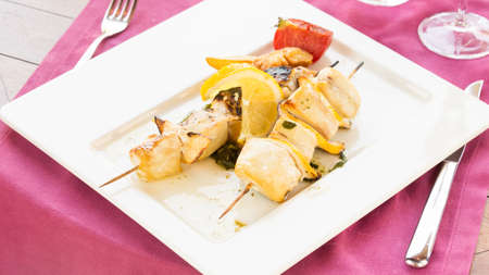 wide screen: Swordfish on skewer with tomato and pepper. Horizontal, wide screen Stock Photo