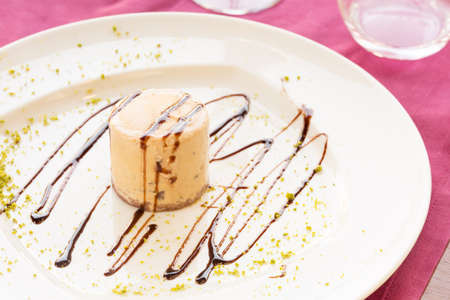 sause: Semifreddo with walnut and chocolate sause in a restaurant. Horizontal Stock Photo