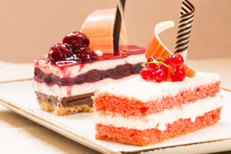 warm color: Currant and cherry cakes in a patisserie. Warm color. Horizontal