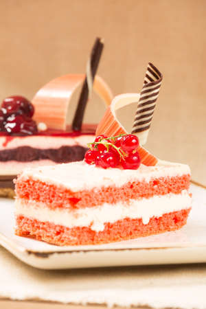 warm color: Currant and cherry cakes in a patisserie. Warm color. Vertical