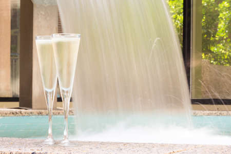 Two glasses of champagne near outdoor jacuzzi. Romantic getaway. Valentines background. Horizontal, sharp background