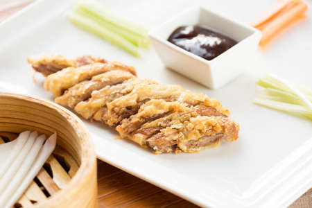 peking: Peking roast duck in a chinese restaurant. With rice pancakes. Authentic local food. Horizontal Stock Photo