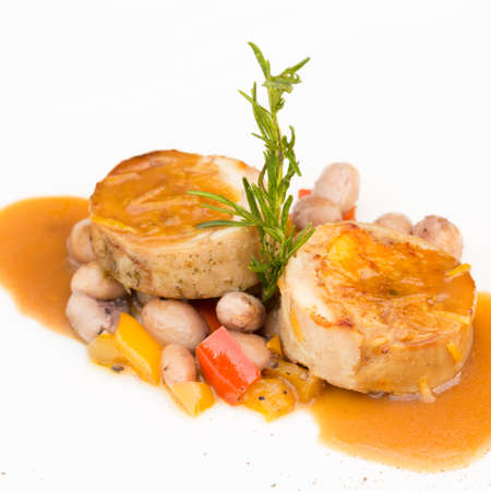 haricot: Rabbit stuffed with wild mushrooms, served with sauted haricot beans. French cuisine. Square