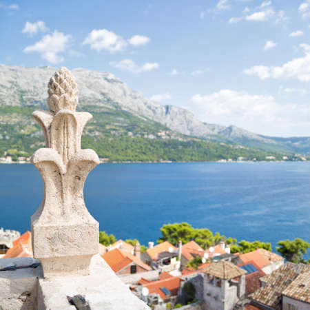 tourist spot: General view from bell tower of Sveti Marko cathedral, Korcula Old Town, Croatia. Scenic landscape of medieval town and sea. Tourist destination in Europe. Square