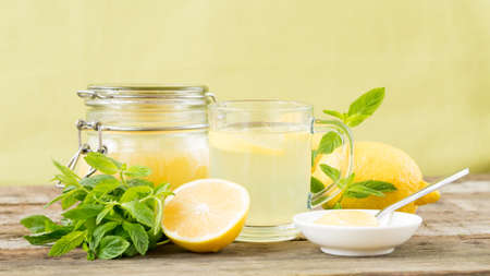 wide screen: Water with lemon and honey. Best start of the day. Healthy drink. Front view. Horizontal, wide screen format