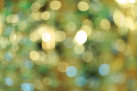 Holiday blurred bokeh background. Christmas background. Horizontal. Warm green tone with yellow