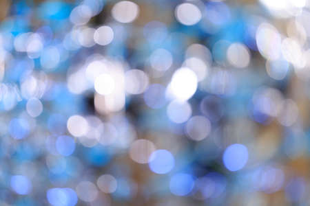 Holiday blurred bokeh background. Christmas background. Horizontal. Cold blue tone with beige Reklamní fotografie
