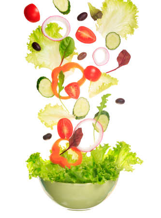 Green salad flying to the bowl. Fantasy salad. Isolated on white. Vertical Stock Photo