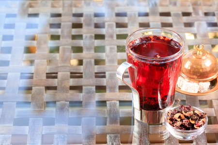 caffeine free: Concept of herbal tea. Hibiscus tea in a glass mug with turkish locum. Healthy caffein-free drink. Neutral background. Horizontal Stock Photo