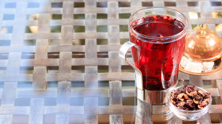 locum: Concept of herbal tea. Hibiscus tea in a glass mug with turkish locum. Healthy caffein-free drink. Neutral background. Horizontal, wide screen format