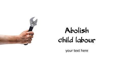 Abolish child labour! Dirty child hand with wrench. Isolated on white. Horizontal
