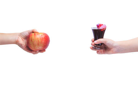 Eat healthy! Concept of healthy food. Concept of junk food. Child hand with apple and with cola and jelly bears. Isolated on white. Horizontal