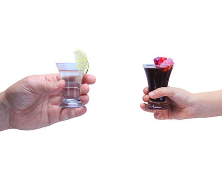 drink responsibly: Drink responsibly!  Adult hand with shot of tequila and kid hand with cola and jelly bears. Isolated on white. Horizontal
