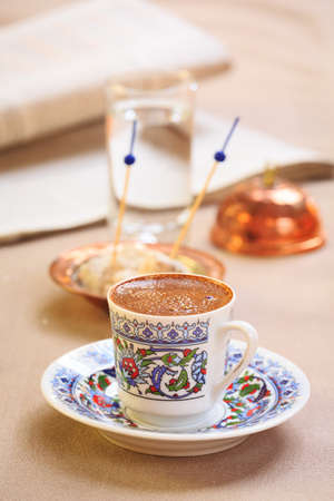 Concept of turkish coffee. Turkish delight on authentic plate. Vertical Imagens