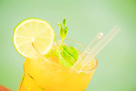 Mango mojito on the wooden pier. Concept of luxury tropical vacation. Classic cocktail. Toned, close up,right-side incline, horizontal,