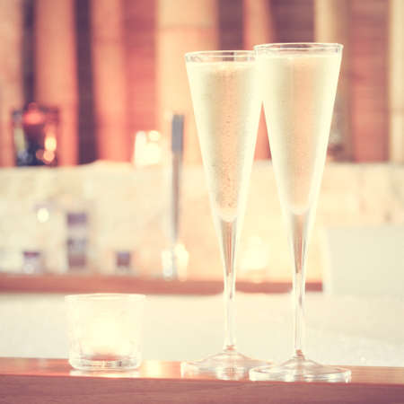 swimming candles: Two glasses of champagne with candle near jacuzzi. Valentines background. Romance concept. Square, toned Stock Photo