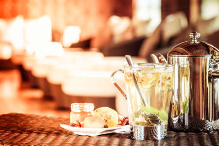 tea filter: Camomile tea with dried fruits. Spa time concept. Spa lounge area.  Horizontal, tone filter