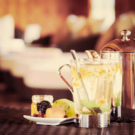 tea filter: Camomile tea with dried fruits. Spa time concept. Spa lounge area.  Square, tone filter