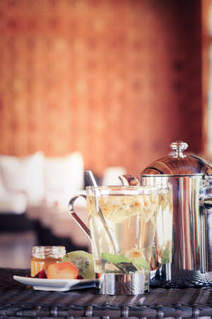Camomile tea with dried fruits. Spa time concept. Spa lounge area.  Vertical, horizont level, tone filter