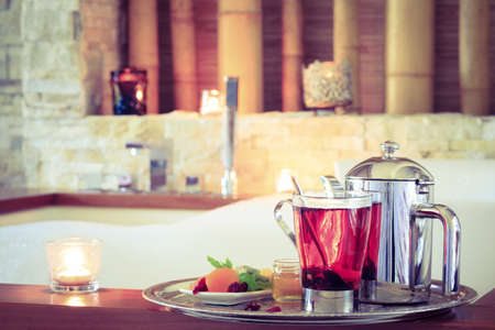 tea filter: Rosehip tea near jacuzzi. Valentines background. Romance concept. Health concept. Horizontal, tone filter
