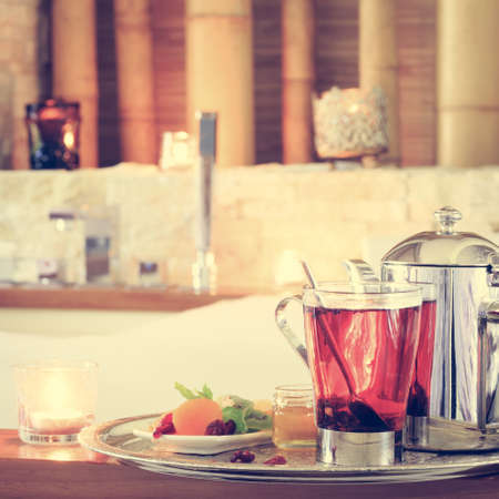 tea filter: Rosehip tea near jacuzzi. Valentines background. Romance concept. Health concept. Square, tone filter