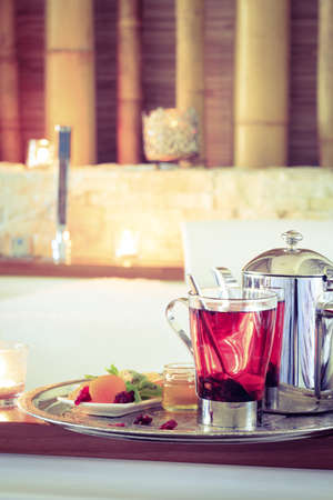 tea filter: Rosehip tea near jacuzzi. Valentines background. Romance concept. Health concept. Vertical, tone filter Stock Photo