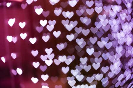 heart tone: Heart shaped holiday blurred bokeh background. Valentine background. Christmas background. Horizontal.