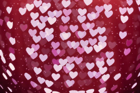 heart tone: Heart shaped holiday blurred bokeh background with sparkles. Valentine background. Christmas background. Horizontal.