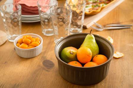 Concept of friendly family dinner party preparation. Warm light, shallow depth of field. Horizontal 版權商用圖片