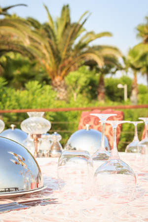 Special occasion table setting in a luxury outdoor restaurant. Festive celebration background. Vertical