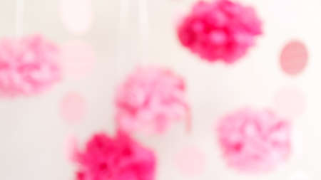 Paper flowers at the girl baby shower party. Baby shower celebration concept. Festive party background. Horizontal, wide screen format