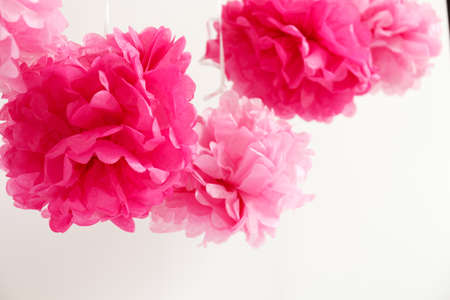 expected: Paper flowers at the girl baby shower party. Baby shower celebration concept. Festive party background. Horizontal