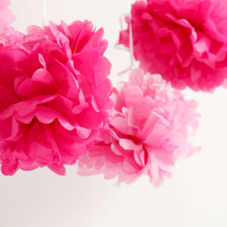 expected: Paper flowers at the girl baby shower party. Baby shower celebration concept. Festive party background. Square Stock Photo